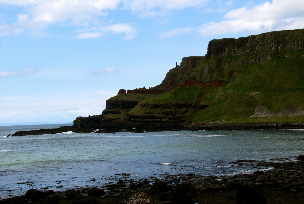 This is the headland on the beach just past the Giant's Causeway. I'm not sure if the little pillars you can see on it are natural or man-made.