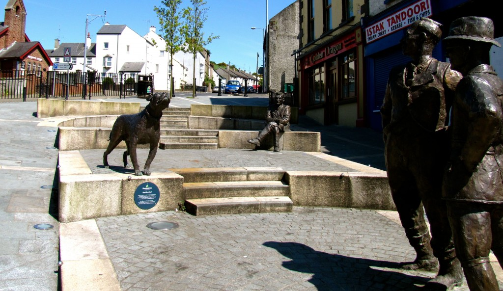 Okay. Saw these statues in the streets in Downpatrick and went to have a look. They are of Lynn Doyle, a Downpatrick writer, and three characters (a dog and two men) from one of his short stories. I got the low-down on him from an elderly nun and three of her friends, and then a little bit more from a clerk in a nearby store where I went to buy something to drink. The Downpatrick folks are all so friendly!