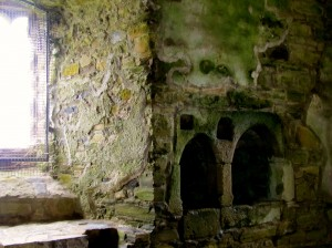 The little cubbyhole in the chapel wall had a little depression in it that filled with rainwater from the water collection system of the castle. The water would be blessed, and any leftover would be let out a drain in the bottom to return to the earth.