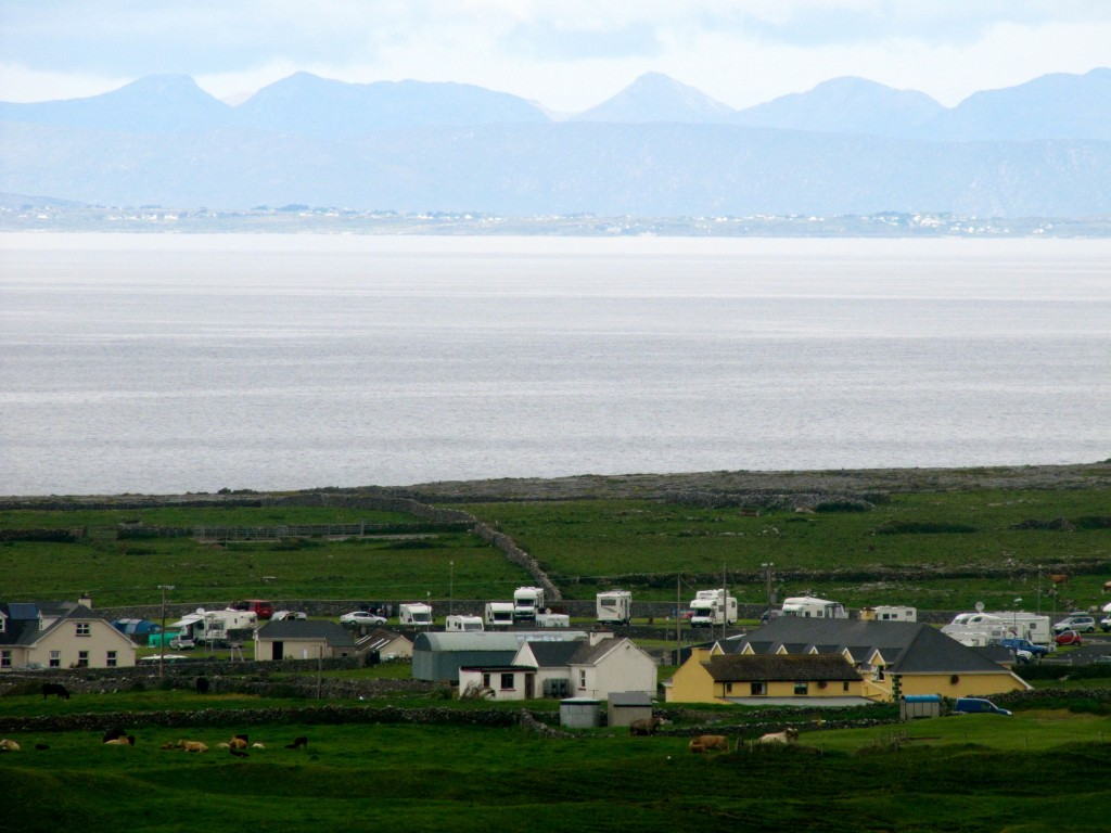 Looking down at Doolin and across Galway Bay at the Connemara coastline.