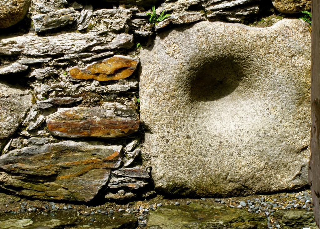 This stone was probably used as a mortar by the pre-Christians who lived in this area before the arrival of St. Kevin. Such a stone would be used primarily for grinding herbs for medicine by the holy men/women of the clan. It was taken to be the cornerstone of the new church here.