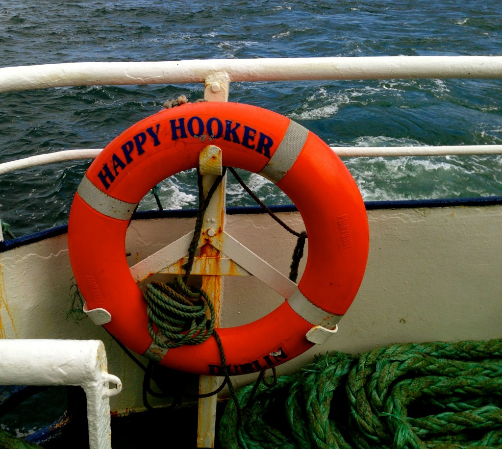 Yes, the name of the ferry is Happy Hooker. It's important to point out that a Galway Hooker is a type of traditional fishing boat.