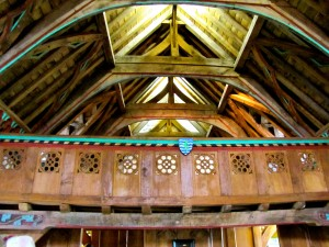 The loft facing the high table, and the decorative roof.