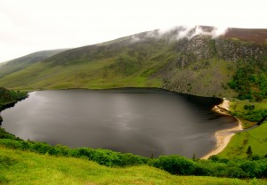 Lough Tay is owned by the Guinness family. As a wedding present for one of the women marrying into the family, they bought an estate at the edge of this lough, and imported sand to make the dark lough water look like a pint of Guinness with a head.