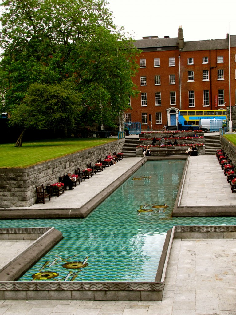 The reflecting pool is cross-shaped to honour Christianity. The mosaic in the pool honours the pre-Christian heritage of the island, showing Celtic weapons tossed down in honour of fallen warriors. There are numerous benches here, and it's a popular picnic spot.