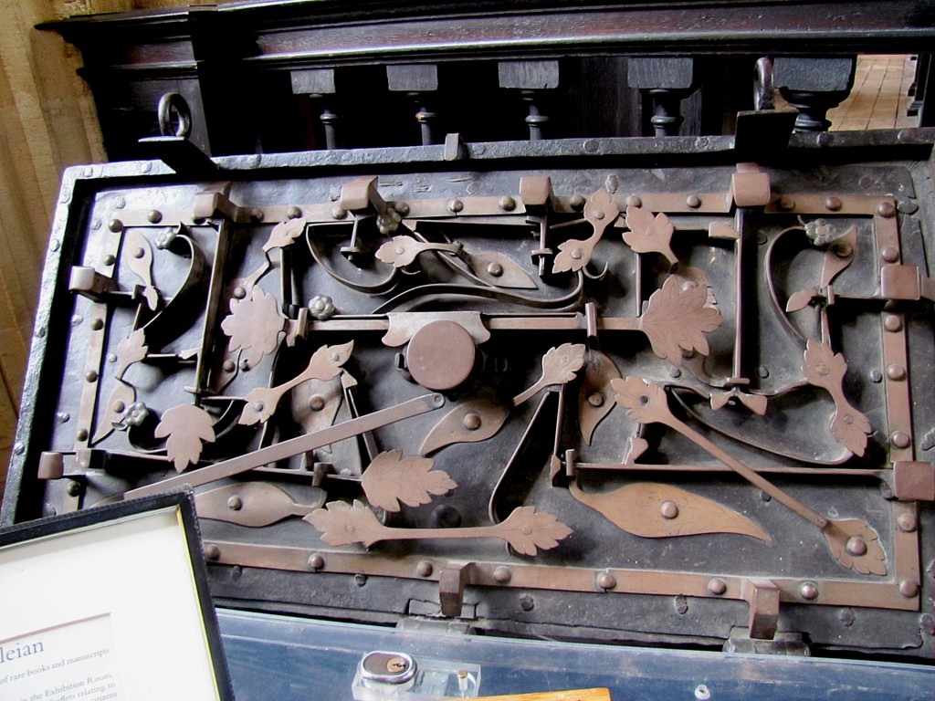 In here with a slot for donations, sits Thomas Bodley's black iron strongbox. The lid is open and, as you can see, the underside is a complex set of levers, rods, springs, and plates. These are the rather elaborate locks that were used to secure the chest.