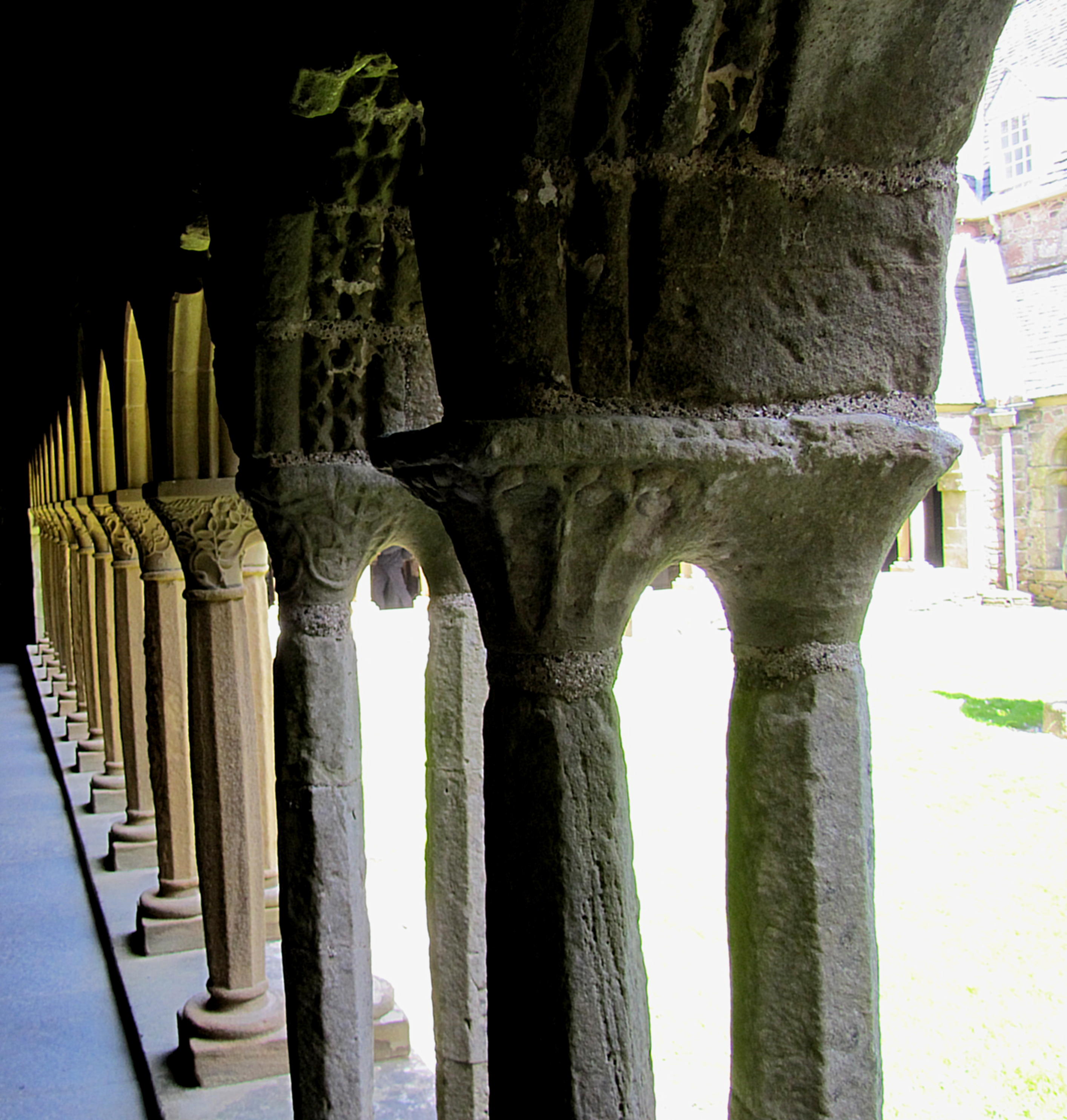 The two column sets in the foreground and the only original cloister columns that have survived. The rest have been recreated, and each set carved uniquely by a different stonemason while working on restoration of the abbey. They did these columns in their spare time, over the course of thirty years.