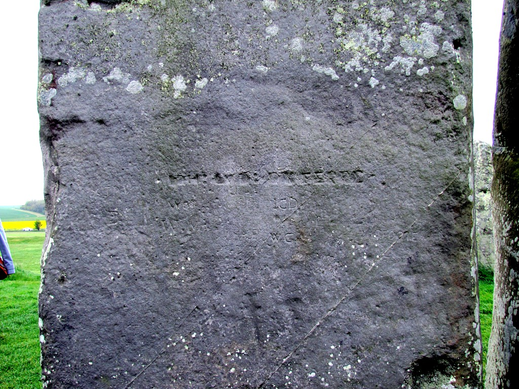 Graffiti on the stones. The deep-cut, straight line is from the Tudor era, so around 400 years old. Most of the rest seem to be later, around Victorian era. But down near the bottom, there are carvings of a dagger and a hammer, that date from the early bronze age, so around 3000 - 4000 years old.