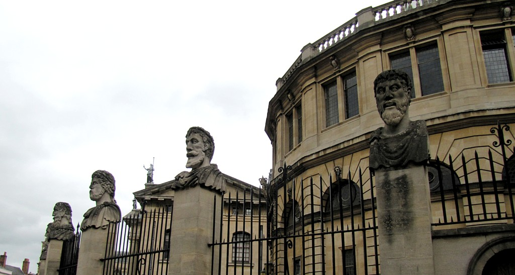 Okay. These heads, on the fence surrounding the Sheldonian Theatre, are called the Philosophers. That said, no one seems really sure who or what they represent: philosophers, emperors, the disciples, or what. The fact that they have kind of slack-jawed, gormless expressions, the sarcastic title of Philosophers seems to have stuck.