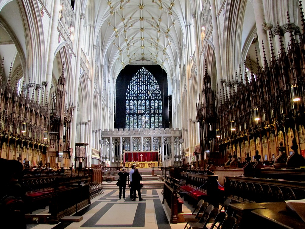 This is the Quire, or Choir. They spell it with the Q in York. It's where the clergy and chorus sit when there's a full service, though attendance these days means that entire services are held here. You can see the crests for various clerical positions and bishoprics along the back row. This is the area below the central tower, behind the screen with the statues of church primates. It's big enough to be a church all on its own.