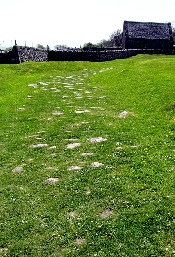 This is the Road of the Dead. It originally led from the Bay of Martyrs, back by the village, up to the abbey, and is the route that chieftains would be carried for burial at the abbey. Most of the road is underneath the current ground level, but this section, near the abbey, is all that remains above ground.