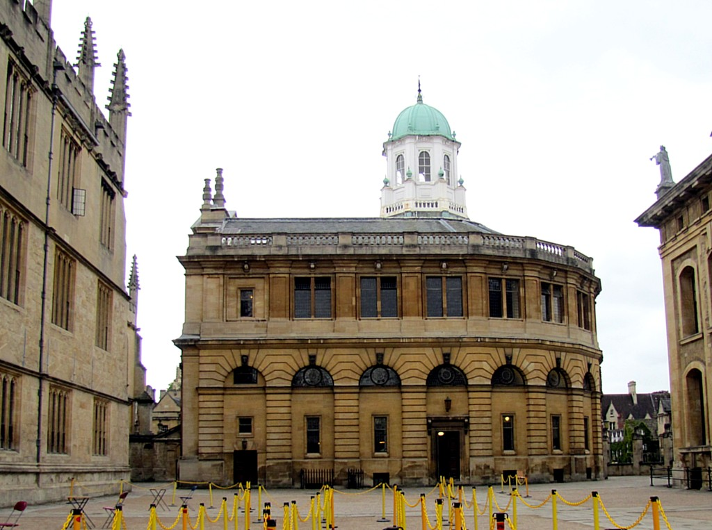 This is a side view of the Sheldonian Theatre. It's where most of the big ceremonies - like graduations - are held. You can see the rope lines set up to keep the students in line. It was designed by Christopher Wren while he was studying Astronomy at Oxford, and is apparently a masterpiece of criss-crossing beams supporting the ceiling, rather than using columns.