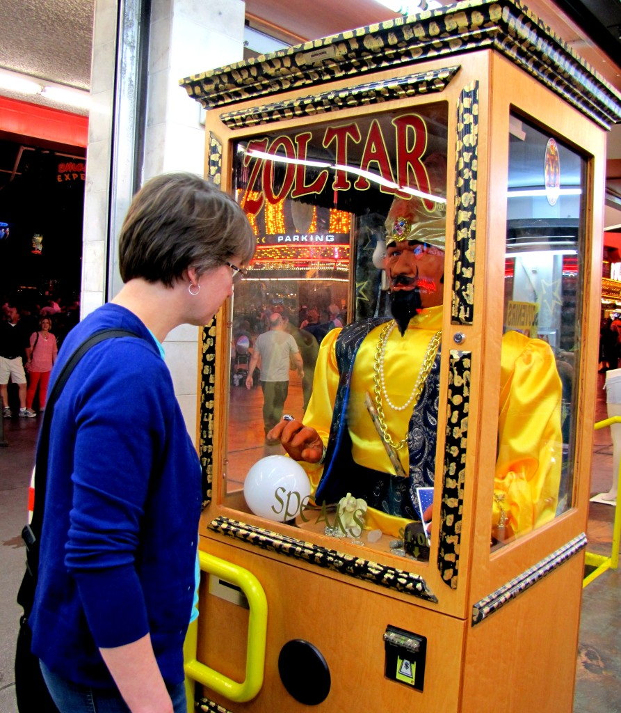 Sandy spotted the Zoltar machine, and stopped to have her fortune told.