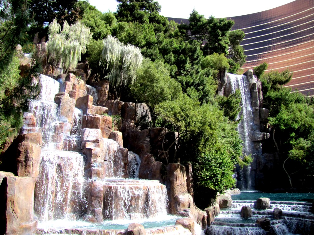 These waterfalls, entirely artificial, of course, are tucked in a twist of path in front of the Wynn casino, which is the copper building you can see in the background.